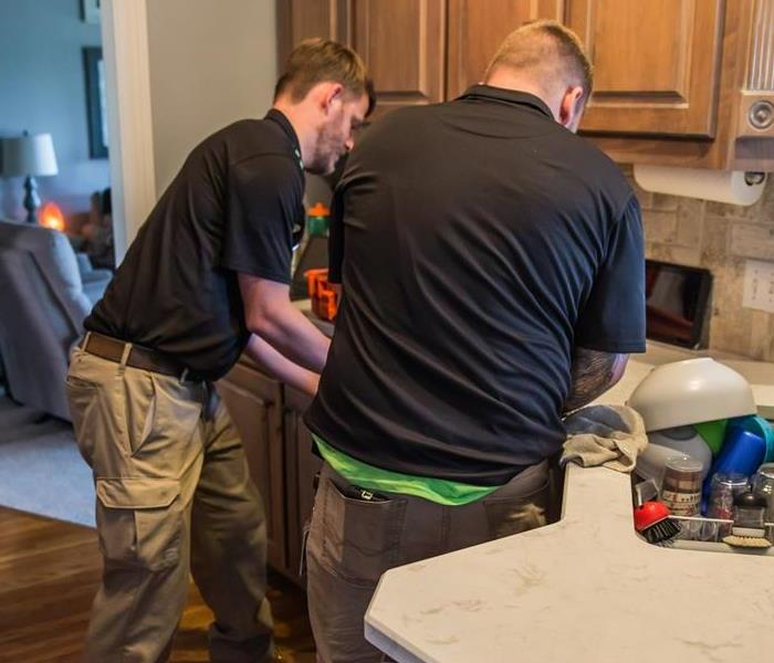 SERVPRO technicians in kitchen