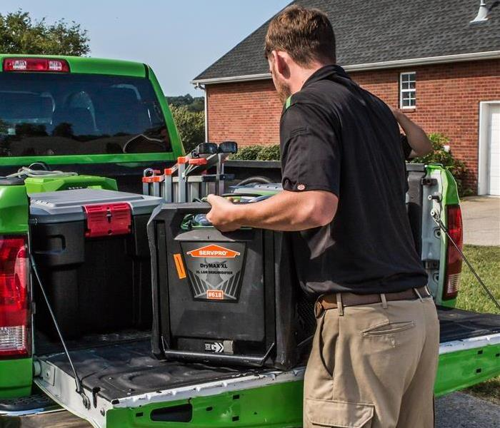 SERVPRO technician next to truck