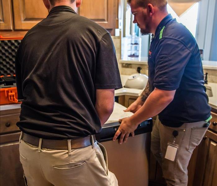 SERVPRO specialists in kitchen