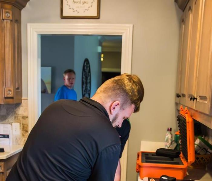SERVPRO workers in kitchen